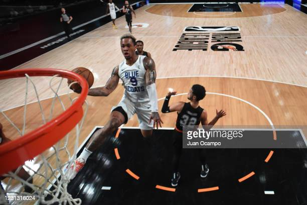 Rayjon Tucker of the Delaware Blue Coats shoots the ball against the Austin Spurs on February 21, 2021 at AdventHealth Arena in Orlando, Florida....