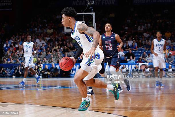Rayjon Tucker of the Florida Gulf Coast Eagles dribbles the ball in the second half against the Fairleigh Dickinson Knights during the first round of...