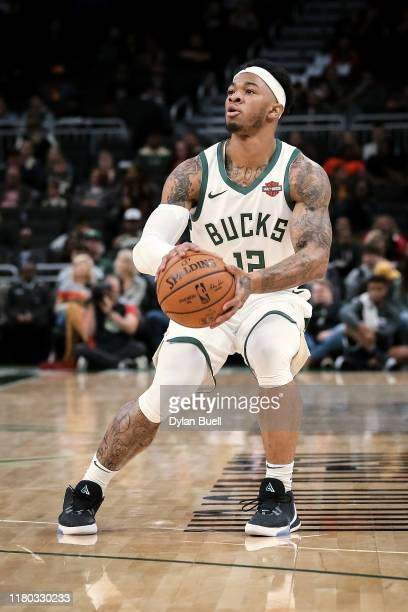 Rayjon Tucker of the Milwaukee Bucks attempts a shot in the fourth quarter against the Utah Jazz during a preseason game at Fiserv Forum on October...