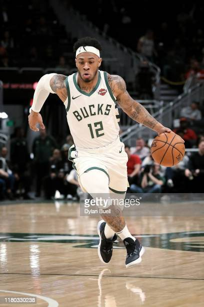 Rayjon Tucker of the Milwaukee Bucks dribbles the ball in the fourth quarter against the Utah Jazz during a preseason game at Fiserv Forum on October...