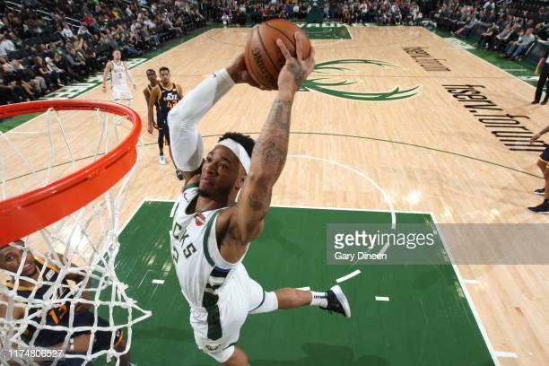 Rayjon Tucker of the Milwaukee Bucks dunks the ball against the Utah Jazz on October 9 2019 at the Fiserv Forum Center in Milwaukee Wisconsin NOTE TO...