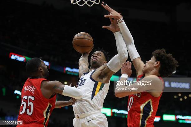 Rayjon Tucker of the Utah Jazz dunks the ball over E'Twaun Moore of the New Orleans Pelicans and Jaxson Hayes of the New Orleans Pelicans at Smoothie...
