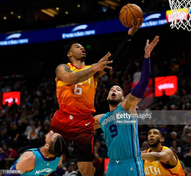 Rayjon Tucker of the Utah Jazz shoots over Willy Hernangomez of the Charlotte Hornets during a game at Vivint Smart Home Arena on January 10 2019 in...