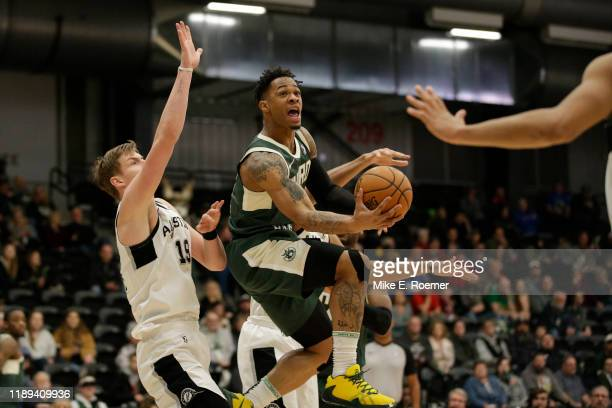 Rayjon Tucker of the Wisconsin Herd drives to the basket as Luka Samanic of the Austin Spurs defends during an NBA GLeague game on December 17 2019...