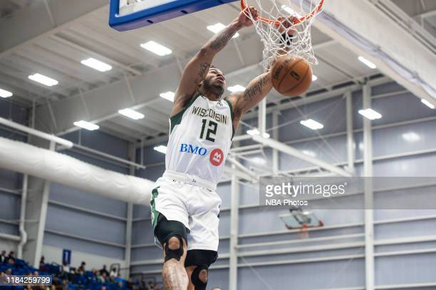 Rayjon Tucker of the Wisconsin Herd of the Wisconsin Herd dunks the ball on the Delaware Blue Coats during an NBA G League game on November 23 2019...