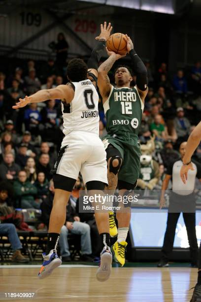 Rayjon Tucker of the Wisconsin Herd shoot as Keldon Johnson of the Austin Spurs Defends during an NBA GLeague game on December 17 2019 at the...