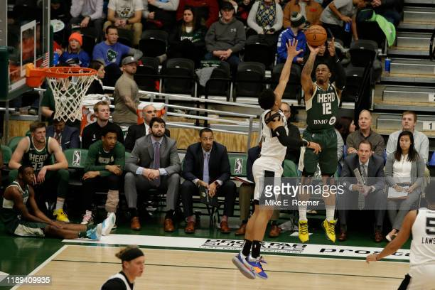 Rayjon Tucker of the Wisconsin Herd shoot over the defense of the Austin Spurs NBA GLeague game on December 17 2019 at the Menominee Nation Arena in...