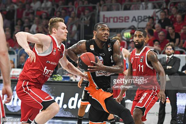 Raymar Morgan draws to the basket against Leon Radosevic and Bradley Wanamaker during the BEKO BBL Final game 1 between Brose Baskets Bamberg and...