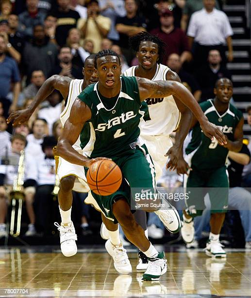 Raymar Morgan of the Michigan State Spartans heads up the court on a fast break during the O'Reilly Auto Parts CBE Classic semifinal game against the...