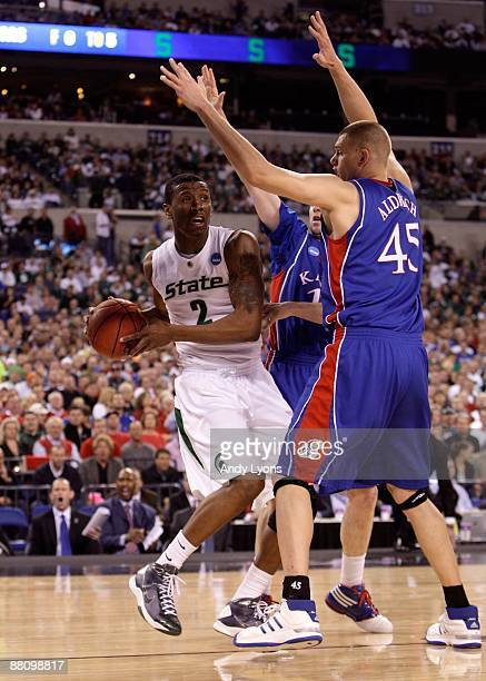 Raymar Morgan of the Michigan State Spartans looks to pass the ball against Cole Aldrich of the Kansas Jayhawks during the third round of the NCAA...