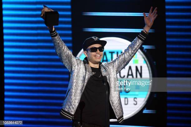 Raymix accepts the Favorite Regional Mexican Song award for 'Oye Mujer' onstage during the 2018 Latin American Music Awards at Dolby Theatre on...