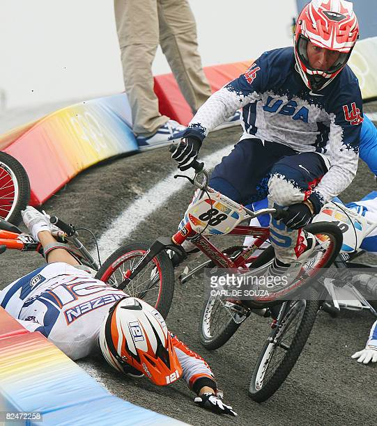 Raymon Van der Biezen of Netherlands and United States' Kyle Bennett crash during their men's cycling BMX quaterfinal at the Laoshan BMX Venue during...