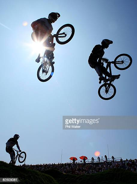 Raymon van der Biezen of the Netherlands and Sifiso Nhlapo of South Africa get air during the Men's BMX semifinal run held at the Laoshan Bicycle...