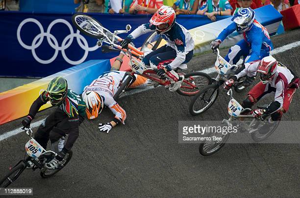 Raymon Van Der Biezen of the Netherlands crashes and takes down Kyle Bennett of the United States, right, during BMX quarterfinals on Wednesday,...