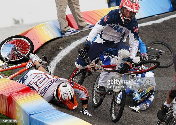 Raymon van der Biezen of the Netherlands crashes causing US cyclist Kyle Bennett to crash and dislocate his left shoulder during the men's BMX...