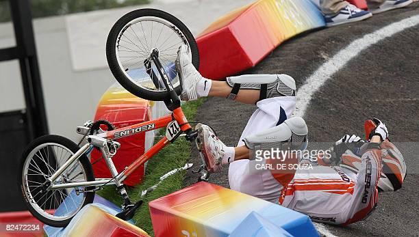 Raymon van der Biezen of the Netherlands crashes during the men's BMX quarterfinals at the Laoshan BMX Venue, in Beijing on August 20, 2008. AFP...