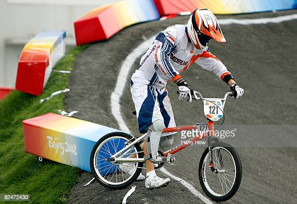 Raymon van der Biezen of the Netherlands gets up after a crash in the Men's Quarterfinals phase of the BMX competition at the Laoshan Bicycle Moto...