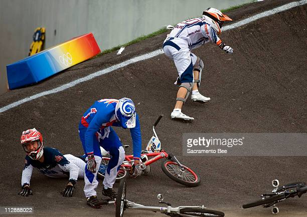 Raymon Van Der Biezen of the Netherlands, top, crashes and takes down Kyle Bennett of the United States, bottom, and Michal Prokop of the Czech...
