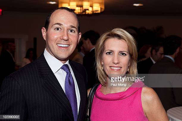 Raymond Arroyo and Laura Ingraham Fox News Contributor and host of the Laura Ingraham Show pose for a photo at the Washington DC Conde Nast Traveler...