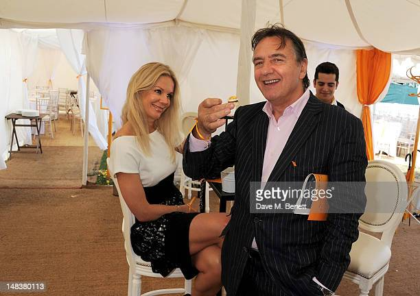 Raymond Blanc and Natalia Traxel attend the Veuve Clicquot Gold Cup Final at Cowdray Park Polo Club on July 15 2012 in Midhurst England