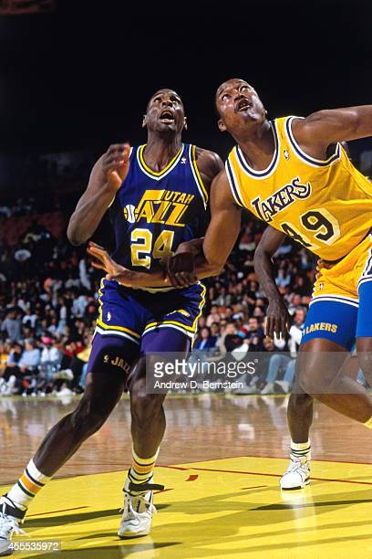 Raymond Brown of the Utah Jazz attempts to rebound the ball against Mel McCants of the Los Angeles Lakers during a game on April 1 1990 at the Great...