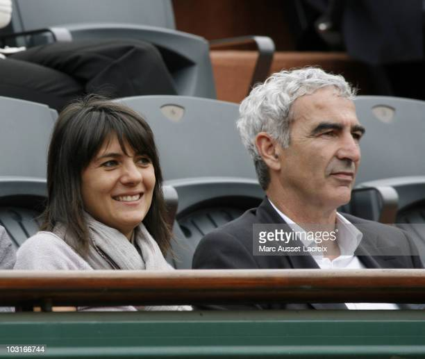 Raymond Domenech and Estelle Denis watching Switzerland's Roger Federer returns the ball to Argentina's Jose Acasuso in their second round match of...