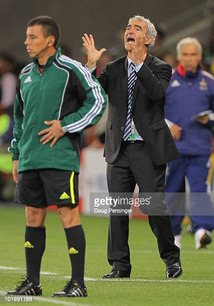 Raymond Domenech head coach of France gestures in frustration as Joel Aguilar the fourth official looks on during the 2010 FIFA World Cup South...