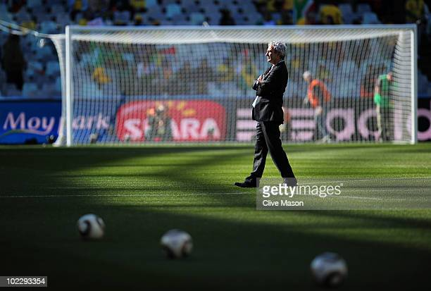 Raymond Domenech head coach of France walks across the pitch prior to the 2010 FIFA World Cup South Africa Group A match between France and South...