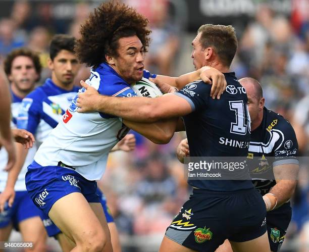 Raymond Faitala of the Bulldogs is tackled by Scott Bolton of the Cowboys defence during the round six NRL match between the North Queensland Cowboys...