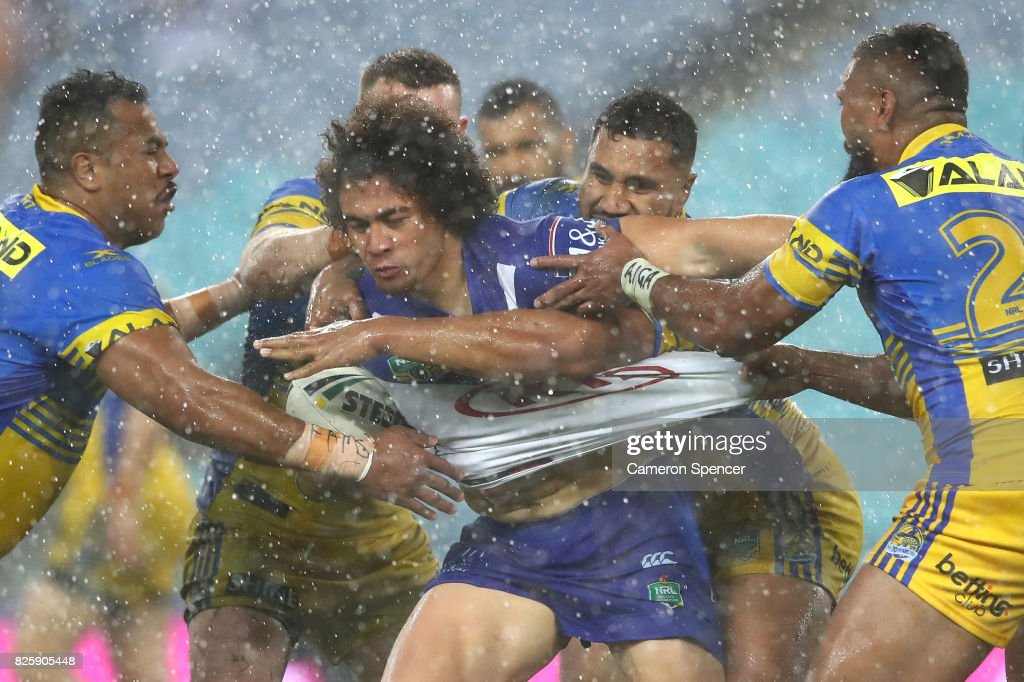 Raymond Faitala of the Bulldogs is tackled during the round 22 NRL match between the Canterbury Bulldogs and the Parramatta Eels at ANZ Stadium on August 3, 2017 in Sydney, Australia.