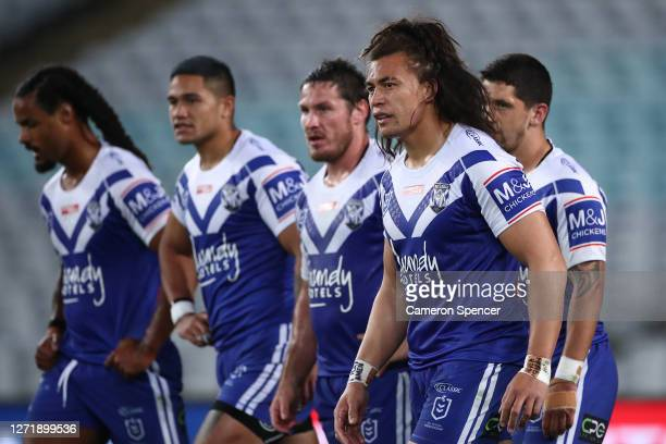 Raymond Faitala-Mariner of the Bulldogs and his team mates look dejected after a Sea Eagles try during the round 18 NRL match between the Canterbury...