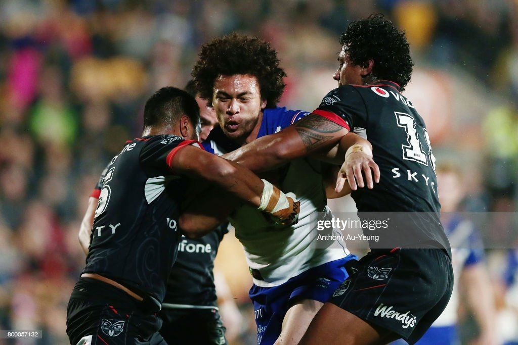 Raymond Faitala-Mariner of the Bulldogs charges against Sam Lisone and James Gavet of the Warriors during the round 16 NRL match between the New Zealand Warriors and the Canterbury Bulldogs at Mt Smart Stadium on June 23, 2017 in Auckland, New Zealand.