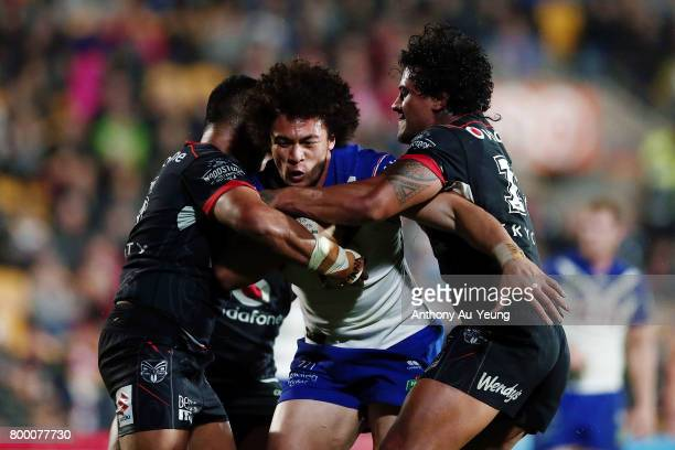 Raymond FaitalaMariner of the Bulldogs charges against Sam Lisone and James Gavet of the Warriors during the round 16 NRL match between the New...