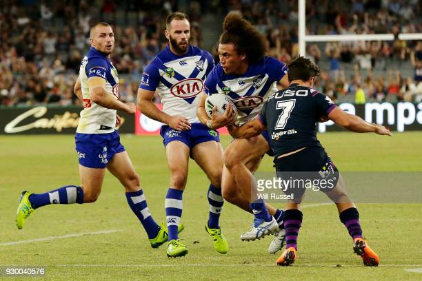 Raymond FaitalaMariner of the Bulldogs fends off Brodie Croft of the Storm during the round one NRL match between the Canterbury Bulldogs and the...