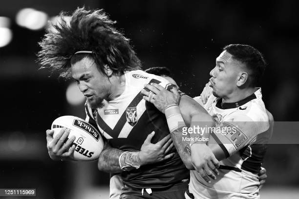 Raymond FaitalaMariner of the Bulldogs is tackled by Jesse Ramien of the Sharks during the round six NRL match between the Cronulla Sharks and the...
