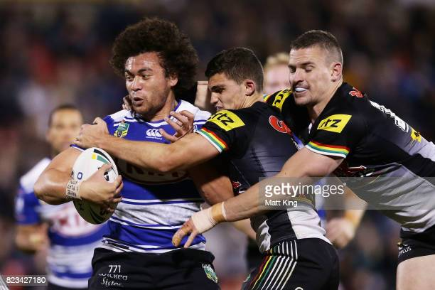 Raymond FaitalaMariner of the Bulldogs is tackled during the round 21 NRL match between the Penrith Panthers and the Canterbury Bulldogs at Pepper...
