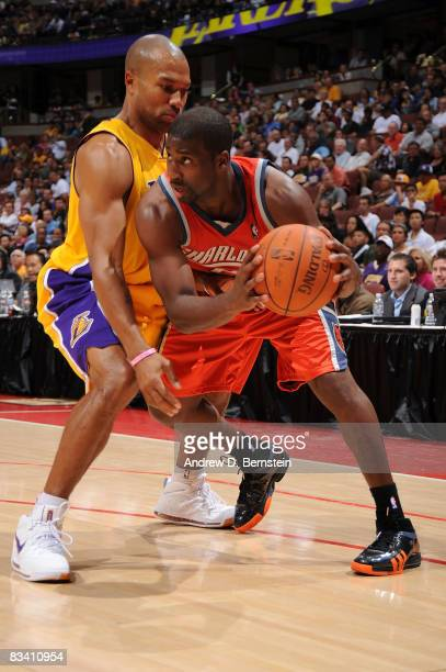 Raymond Felton of the Charlotte Bobcats drives against Derek Fisher of the Los Angeles Lakers during the game on October 23 2008 at Honda Center in...