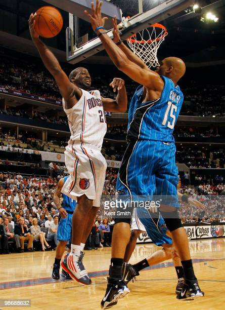 Raymond Felton of the Charlotte Bobcats drives to the basket against Vince Carter of the Orlando Magic in Game Four of the Eastern Conference...