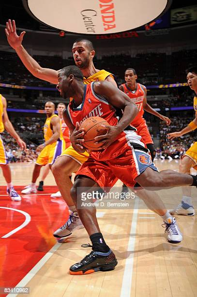 Raymond Felton of the Charlotte Bobcats drives to the basket as Vladimir Radmanovic of the Los Angeles Lakers defends during the game on October 23...
