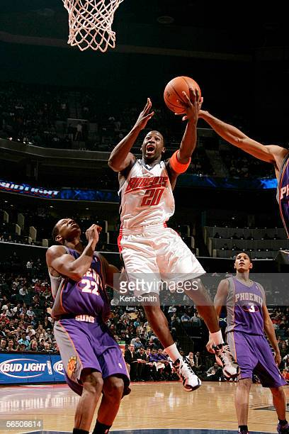 Raymond Felton of the Charlotte Bobcats drives to the basket over James Jones of the Phoenix Suns on December 30 2005 at the Charlotte Bobcats Arena...