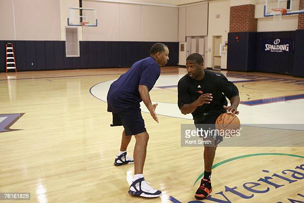 Raymond Felton of the Charlotte Bobcats goes thru his offseason workout as he dribbles around Bobcats assistant coach Dell Curry on August 2 2007 at...