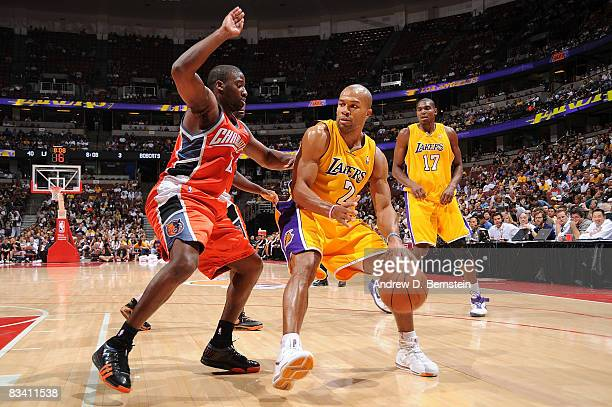 Raymond Felton of the Charlotte Bobcats guards as Derek Fisher of the Los Angeles Lakers drives the ball to the basket during the game on October 23...
