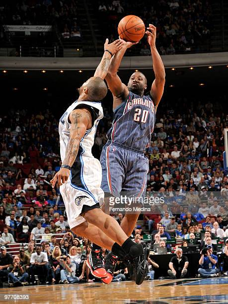 Raymond Felton of the Charlotte Bobcats shoots against Jameer Nelson of the Orlando Magic during the game on March 14 2010 at Amway Arena in Orlando...