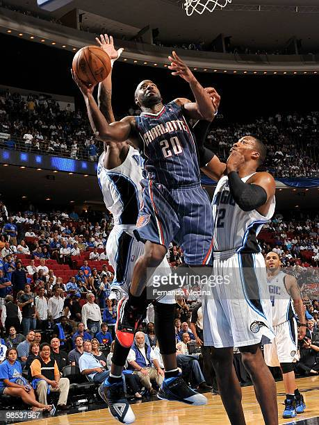 Raymond Felton of the Charlotte Bobcats takes the ball to the basket against Dwight Howard of the Orlando Magic in Game One of the Eastern Conference...