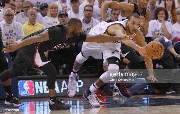 Raymond Felton of the Los Angeles Clippers and Rudy Gobert of the Utah Jazz go for the loose ball in the second half of the 10598 win by the Jazz in...
