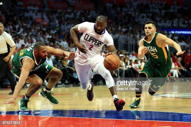 Raymond Felton of the Los Angeles Clippers dribbles through Boris Diaw and Raul Neto of the Utah Jazz during the first half of Game Seven of the...