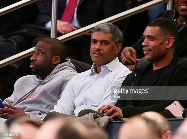 Raymond Felton of the New York Knicks general manager Steve Mills of the Knicks and Allan Houston attend the Providence Friars versus the St John's...