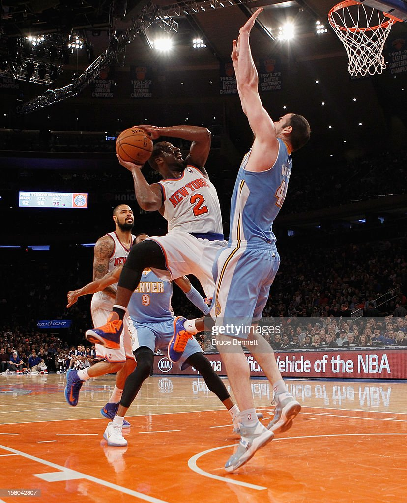 Raymond Felton #2 of the New York Knicks is blocked by Kosta Koufos #41 of the Denver Nuggets at Madison Square Garden on December 9, 2012 in New York City.