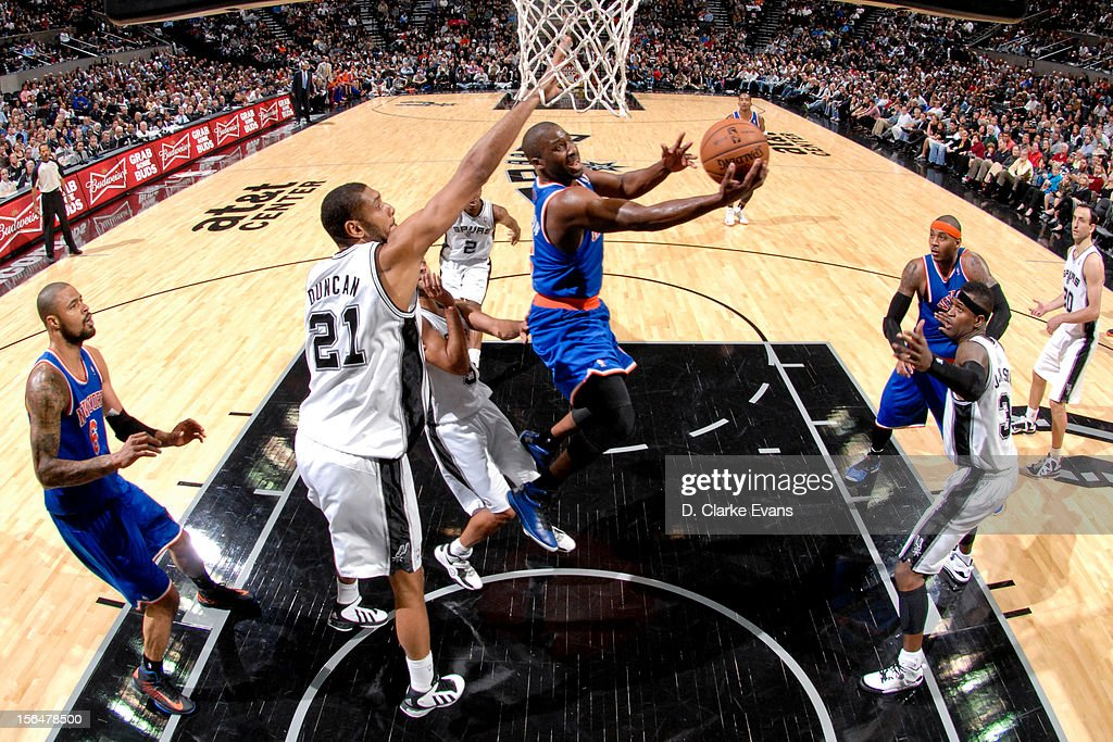 Raymond Felton #2 of the New York Knicks shoots a reverse layup against Tim Duncan #21 of the San Antonio Spurs on November 15, 2012 at the AT&T Center in San Antonio, Texas.