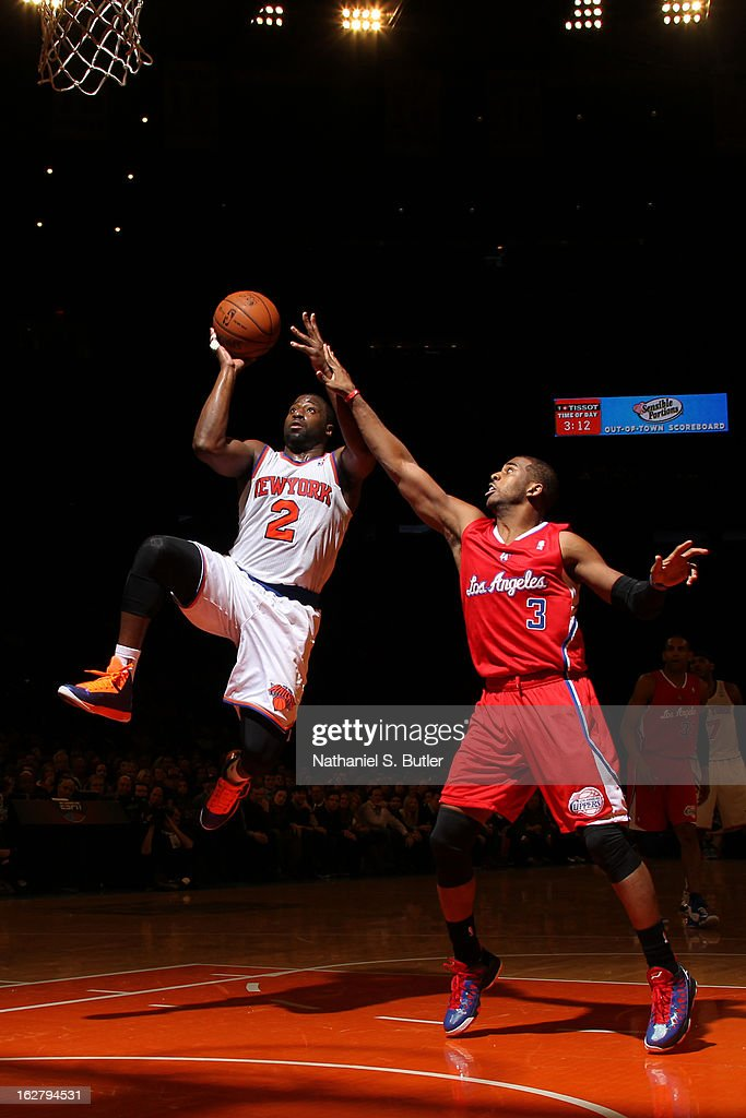 Raymond Felton #2 of the New York Knicks shoots against Chris Paul #3 of the Los Angeles Clippers on February 10, 2013 in a game between the Los Angeles Clippers and the New York Knicks at Madison Square Garden in New York City.